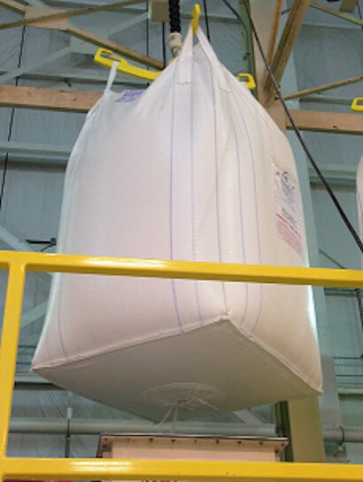 lowering bulk bags into hopper